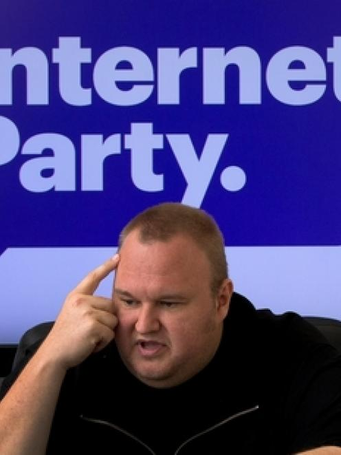 Kim Dotcom says at least one sitting MP has signed up as a member of his new party, but he won't...