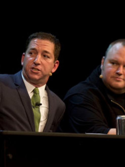 Kim Dotcom with Pulitzer prize-winning journalist and author Glenn Greenwald, left, at The Moment...