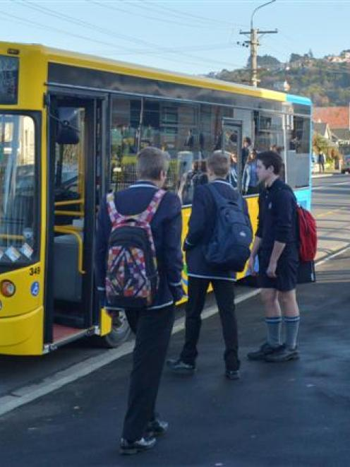 Kings and Queens High School pupils board school buses in Bayview Rd, yesterday afternoon. Photo...