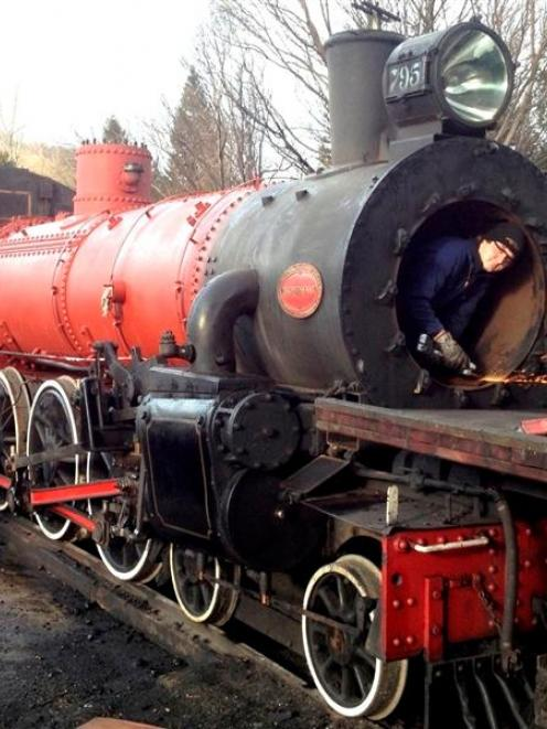 Kingston Flyer crew member George King works on the boiler of Ab 795. Photo supplied.