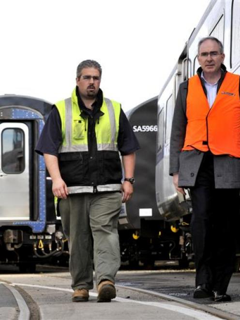 KiwiRail's Hillside workshops acting site manager Andy Bisset (left) and Kiwirail chief executive...