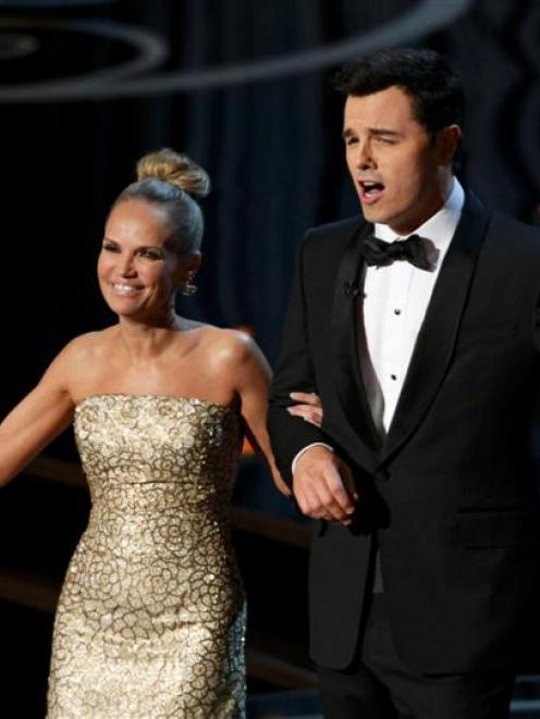 Kristin Chenoweth and Oscars host Seth MacFarlane perform the closing number at the 85th Academy...