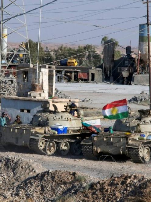 Kurdish security forces take part in an intensive security deployment after clashes with...