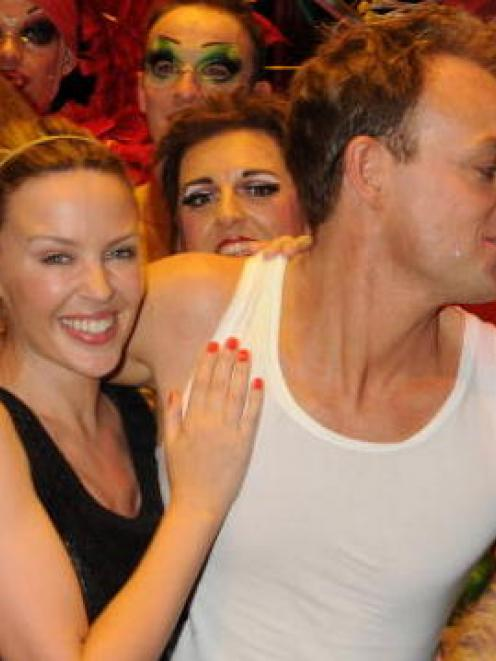 Kylie Minogue and Jason Donovan pose with members of the cast of Priscilla, Queen of the Desert...