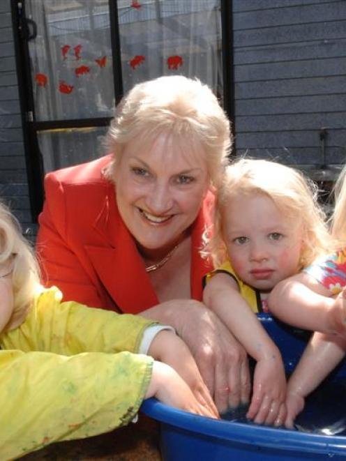 Labour Party deputy leader and social policy spokeswoman Annette King plays with (from left) Kyra...