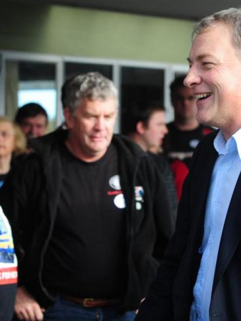 Labour Party leader Phil Goff (right) meets Hillside Workshops workers and delegates, including...