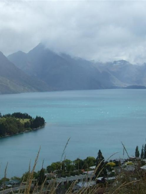Lake Wakatipu yesterday afternoon. It has changed colour following the massive slip at Sandy...