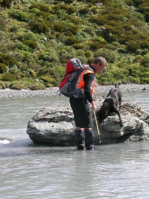 LandSAR volunteer Brent MacDonald, of Arrowtown, with his avalanche tracking dog, black Labrador...