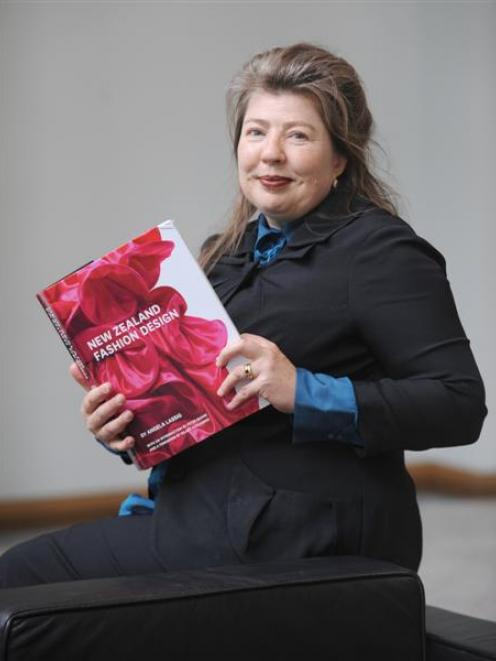 Lassig with her new book. Photo by Peter McIntosh.