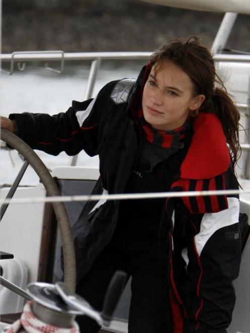 Laura Dekker arrives at Marsden Cove aboard her yacht Guppy.