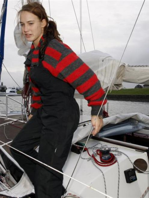 Laura Dekker at Marsden Cove aboard her yacht <i>Guppy</i>. Photos from Northern Advocate.