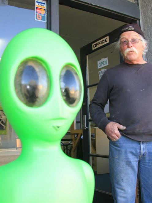 Lawrence artist Graeme Furness with the little green man outside his Exit Studio gallery in the...
