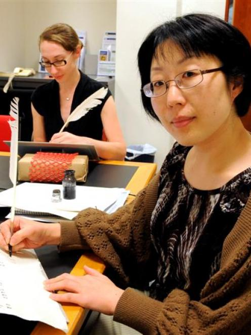 Learning to write with a quill pen at the Rare Book Summer School at the University of Otago...