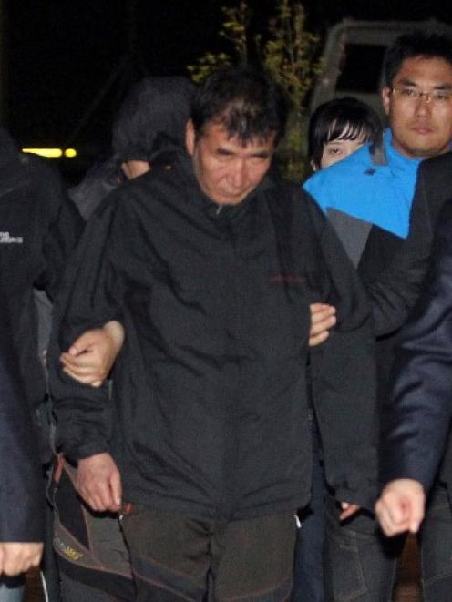 Lee Joon-Seok (C) arrives at a court in Mokpo. REUTERS/Yonhap