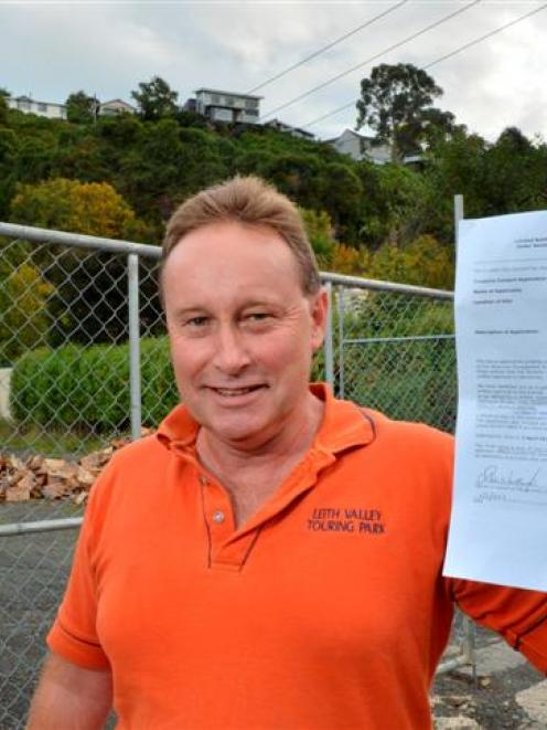 Leith Valley Touring Park co-owner Terry McLaren, also a Braeview Cres resident, holds a copy of...