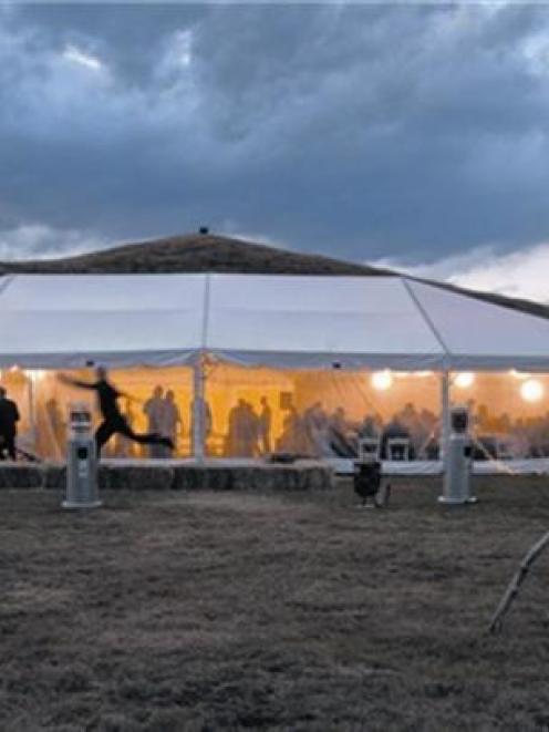 Lights glow from the wedding reception of Suzanah Kearns and Mark Gray at West Arm, Lake Wanaka...