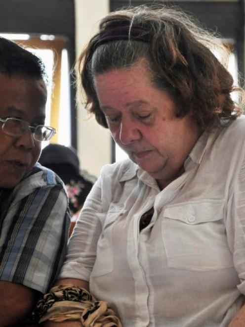 Lindsay Sandiford listens to her translator during her trial in Denpasar in Bali. REUTERS/Stringer