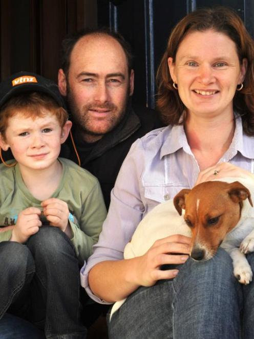 Linkin Soal (5) with his parents Sharon and Gary and their dog Mazy last week. Photo by Gregor...