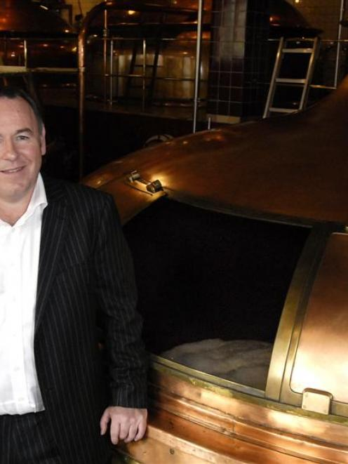 Lion Breweries managing director Peter Kean inspects the product at the Speight's Brewery in...