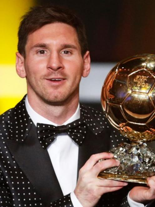 Lionel Messi of Argentina holds the Ballon d'Or trophy during the FIFA Ballon d'Or 2012 football...