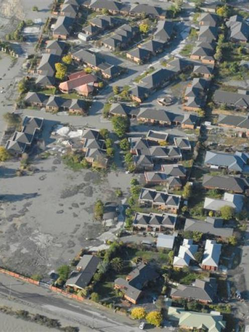 Liquefaction is apparent in this aerial photo of the Burwood-New Brighton area of Christchurch...