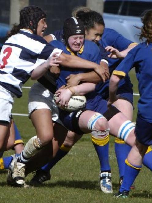 Lisa Waddell, of Otago, is tackled by Auckland defenders Karina Penetito (left) and Bella Milo...