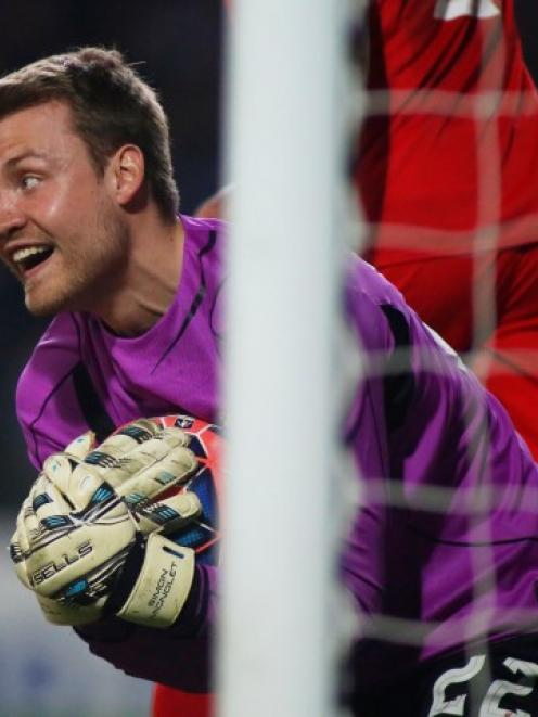 Liverpool goalkeeper Simon Mignolet saves a shot from Blackburn's Simon Eastwood. Photo: Action...