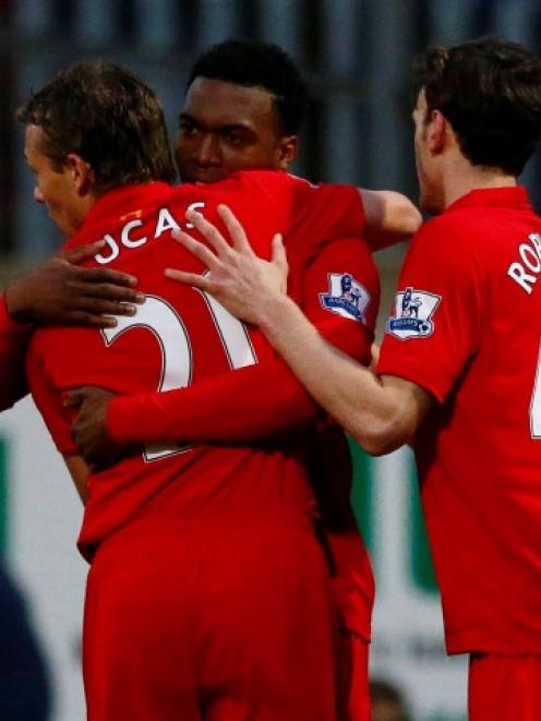 Liverpool's Daniel Sturridge (C) celebrates with Lucas Leiva (L) and Jack Robinson after scoring...