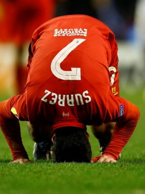 Liverpool's Luis Suarez reacts after his team lost their Europa League match against Zenit St....
