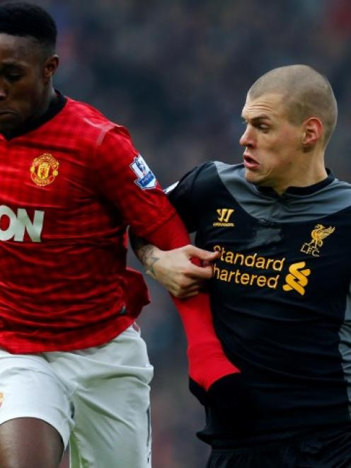Liverpool's Martin Skrtel (R) challenges Manchester United's Danny Welbeck during their English...