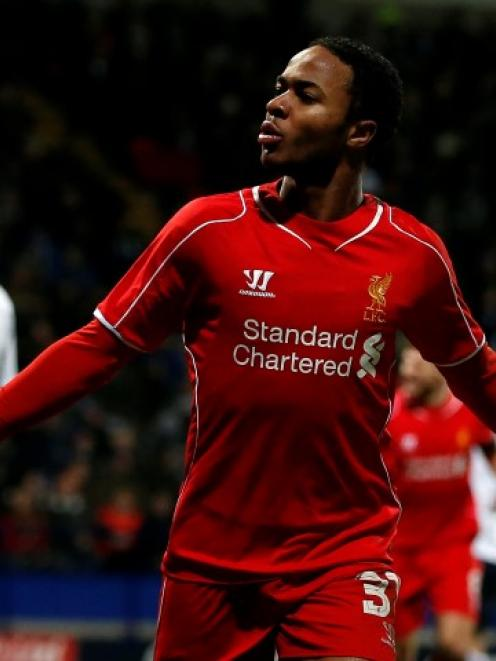 Liverpool's Raheem Sterling celebrates after scoring against Bolton Wanderers at the Macron...