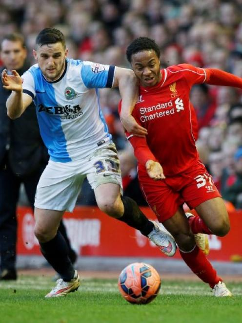 Liverpool's Raheem Sterling (R) contests the ball with Blackburn Rovers' Craig Conway. Reuters /...