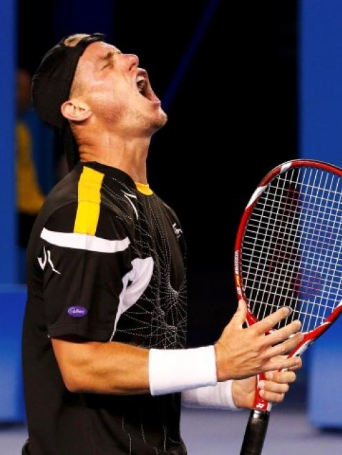 Lleyton Hewitt of Australia reacts during his men's singles match against Janko Tipsarevic of...