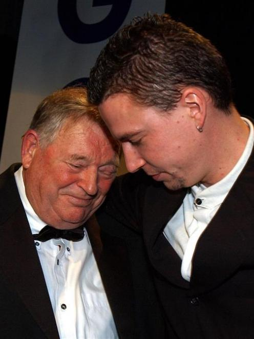 Loader shares a special moment with Duncan Laing during a tribute evening in 2002. Photo by Jane...