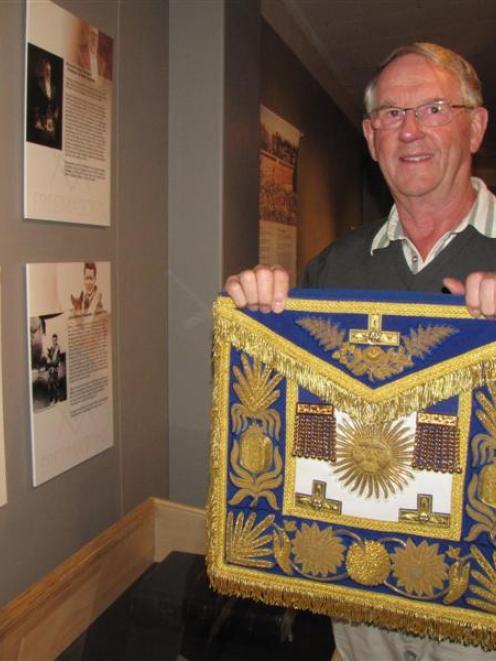 Lodge Arrow Kilwinning No 86 secretary Bob Russell, of Queenstown, presents a grand master's...
