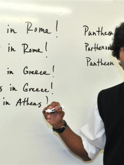 Logan Park High School pupil Tuhin Baucus reminds himself of the difference between Pantheon and...