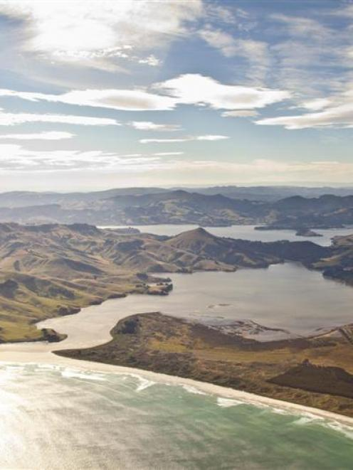 Looking over Allans Beach, with Hoopers Inlet and Harbour Cone centre, Papanui Inlet at right and...