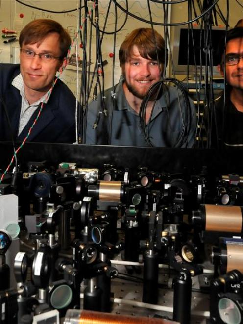 Looking over experimental equipment at the University of Otago Light and Matter Laboratory are ...