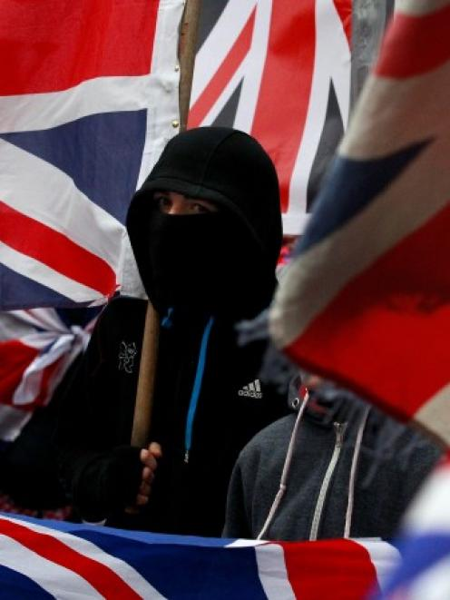 Loyalist protesters demonstrate against restrictions on flying Britain's union flag from Belfast...