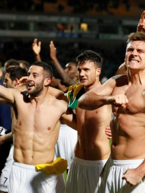 Luton Town's Janos Kovacs (R) celebrates with teammates after they beat Norwich City in their FA...