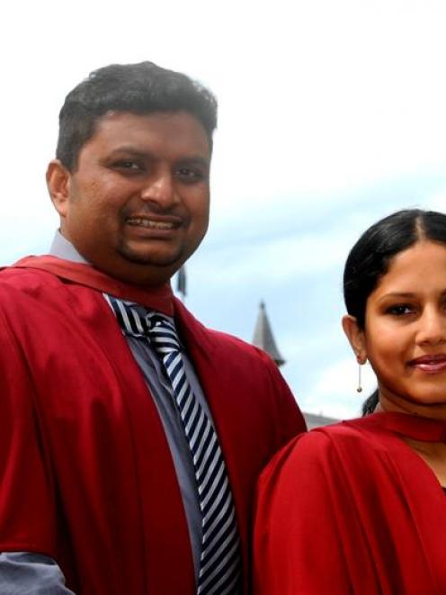 Luxmanan Selvanesan and his wife, Carthika Luxmanan, prepare to graduate from the University of...