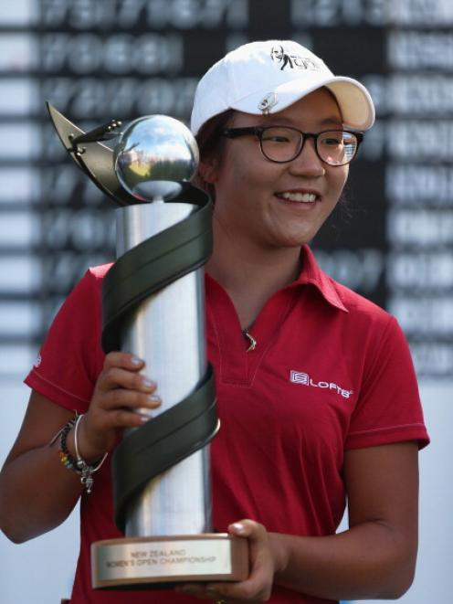 Lydia Ko poses with the trophy after winning the New Zealand Women's Open at Clearwater Golf...