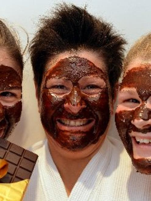Lynette Johnstone (centre) and daughters Celine (left) and Jodie indulge in chocolate facials as...