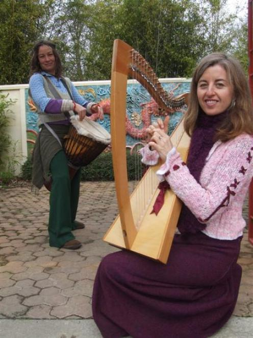 Lynley Caldwell plays her harp while Ra McRostie practices her drumming. Photo by Sally Rae.