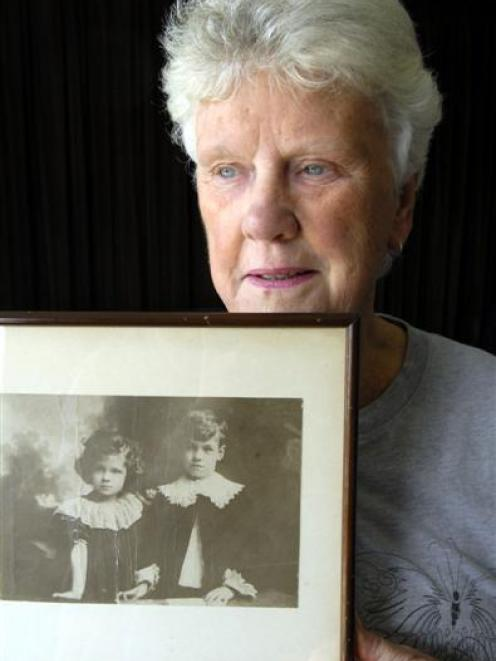 Lynley Mackenzie, of Halfway Bush, with a photo of her father, Harry Ham [left] and her uncle,...