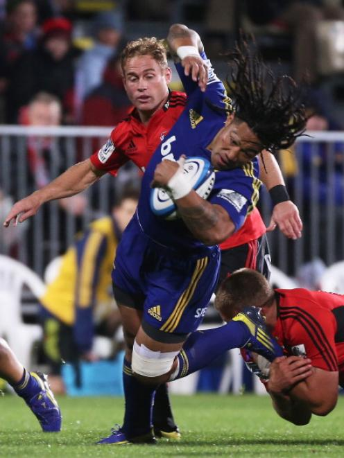 Ma'a Nonu of the Highlanders is tackled by Owen Franks of the Crusaders.  (Photo by Joseph...