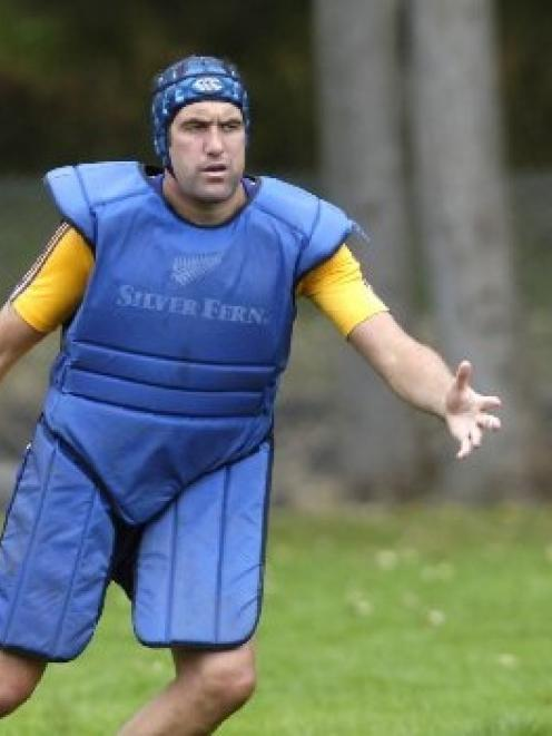 Highlanders lock Hoani MacDonald pads up as he takes part in a training drill at Logan Park. ...