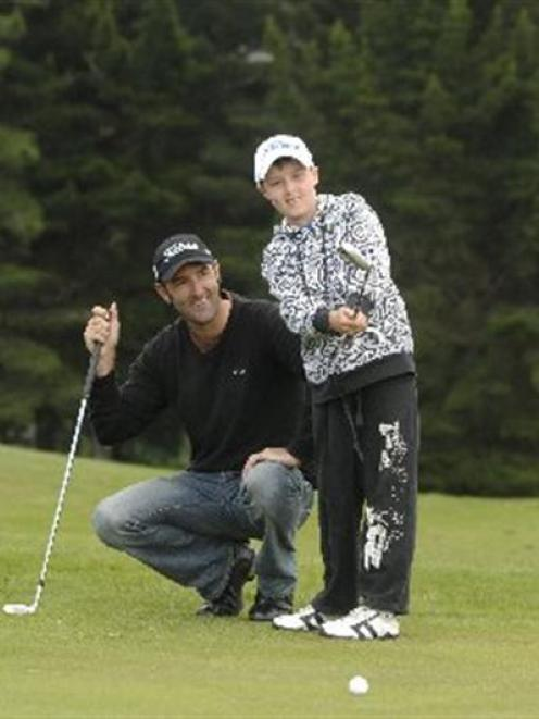 Mahal Pearce observes the form of son Zac (10) at the Balmacewen course yesterday. Photo by Linda...