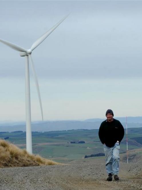 Mahinerangi farmer Richard Reid walks among TrustPower's Mahinerangi wind-farm turbines. Photos...