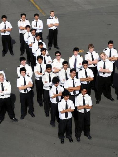 Mainland Aviation College students and college manager John Penno (front, right) at Dunedin...